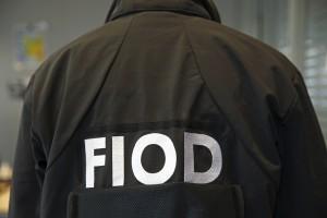 FIOD verricht doorzoekingen en houdt verdachten aan in het kader van een strafrechtelijk onderzoek naar oplichting, witwassen, afpersing en bedreiging